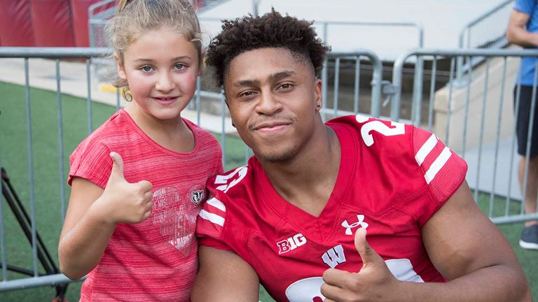 96adb9b477b6 Wisconsin football running back Jonathan Taylor (23) gives a thumbs up with  a young